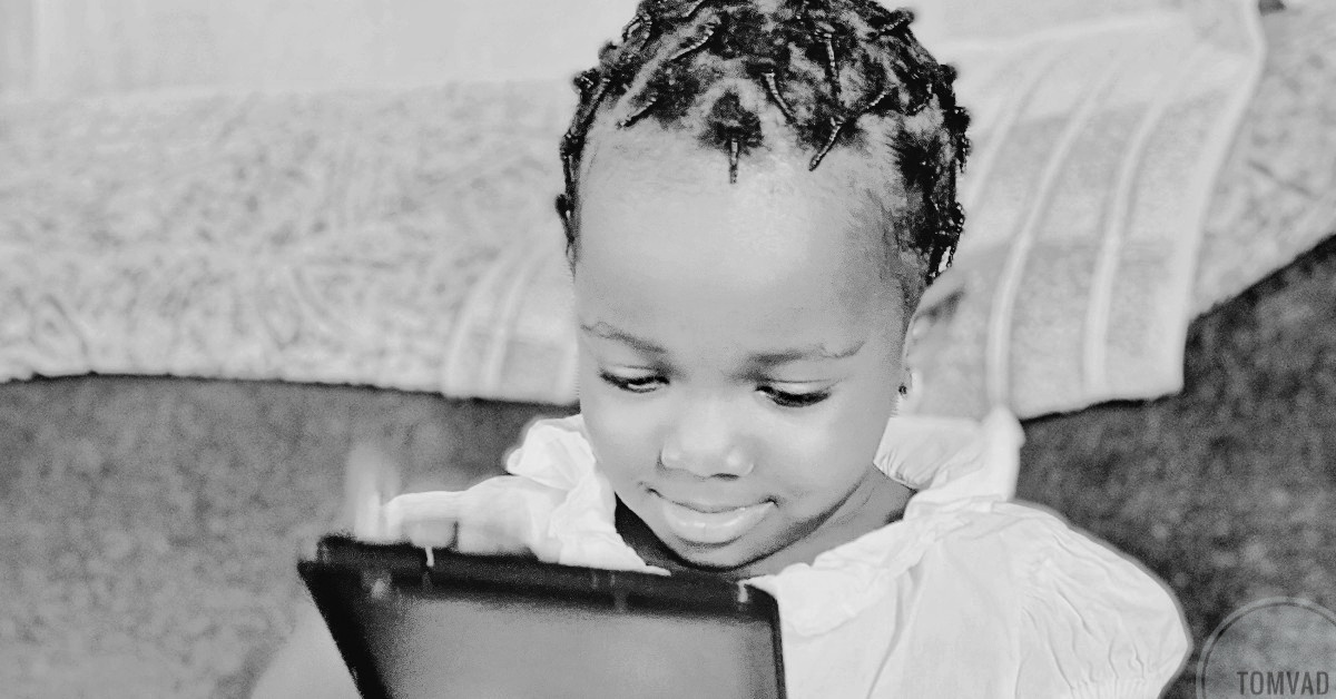 A child operating a tablet