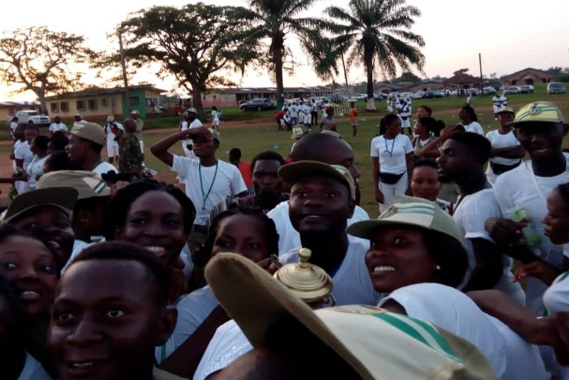 Corpers gather for picture after morning devotion on camp